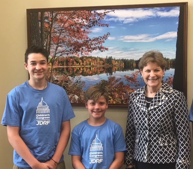 Andy with another youth delegate and Jeane Shahaheen, US Senator from NH.