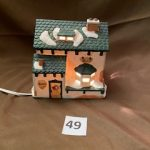#49  Christmas Village lighted Music store  $10.00